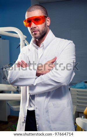 Confident successful doctor at dental clinic