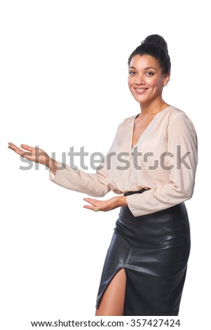 Confident successful mixed race caucasian - african american business woman showing open hand palm with copy space for product or text - stock photo