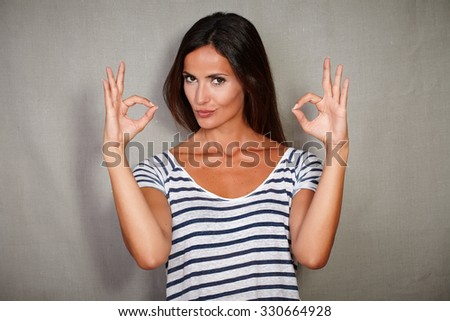 Confident woman in blue blouse congratulating with ok sign