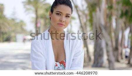 Confident woman in tropical beach scene - stock photo