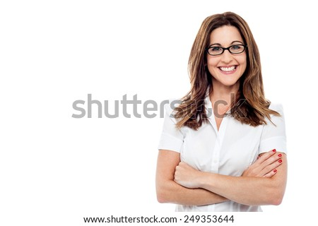 Confident woman keeping arms crossed