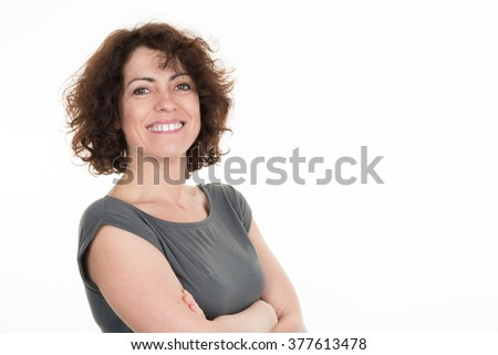 Confident woman keeping arms crossed copy space on the left - stock photo
