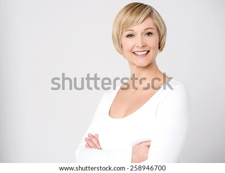 Confident woman posing with folded arms - stock photo