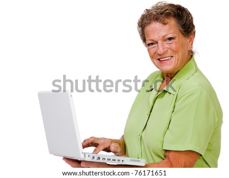 Confident woman using a laptop and posing isolated over white - stock photo