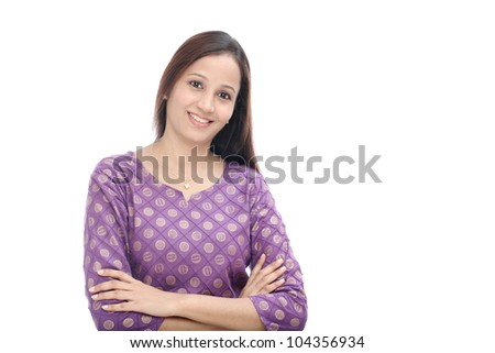 Confident woman with arms crossed against white background