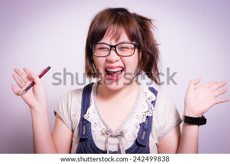 confident woman with her pen, she's looks happy after writting something. - stock photo