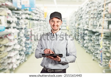 confident worker with tablet and warehouse background - stock photo