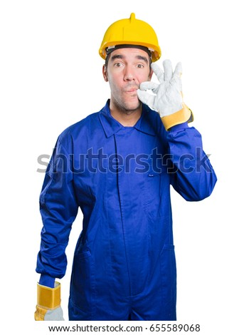 Confident workman keeping a secret on white background