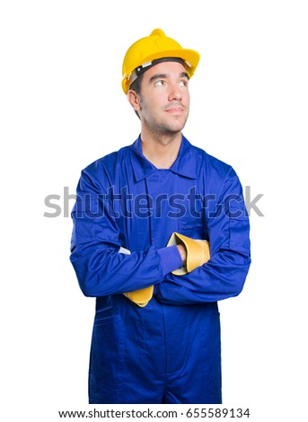 Confident workman looking up on white background
