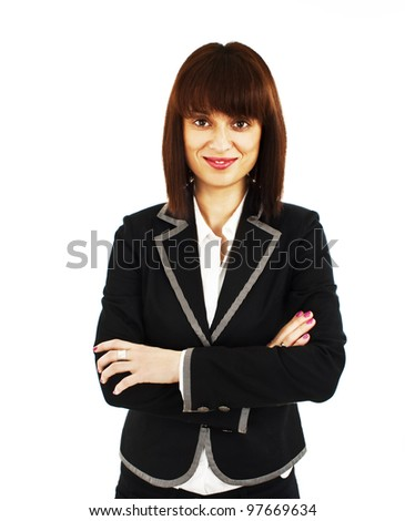 Confident young business lady standing with folded hand.  Isolated on white background