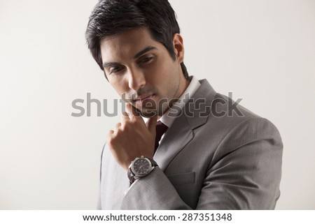 Confident young business man in deep thought