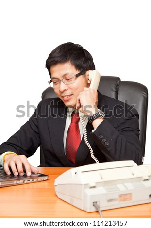 Confident young business man talking on telephone, with clipping path.