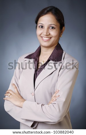 Confident young business woman - stock photo
