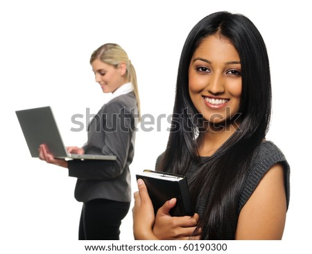 Confident young business woman with co-worker in background - stock photo