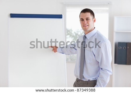 Confident young businessman giving a presentation