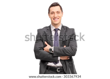 Confident young businessman in a gray suit looking at the camera isolated on white background - stock photo