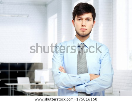 Confident young businessman in his office