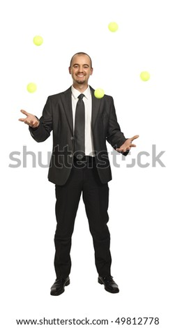 confident young businessman play with balls isolated on white