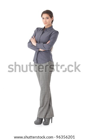 Confident young businesswoman standing arms crossed, looking at camera.? - stock photo