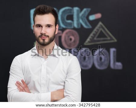 confident young caucasian teacher in a class - stock photo