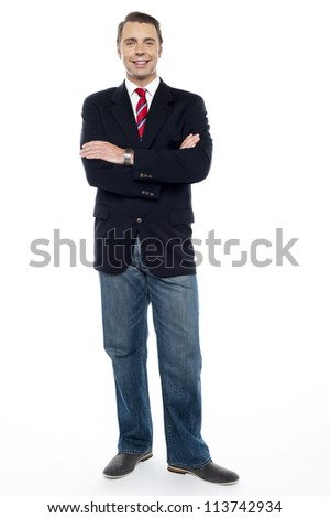 Confident young consultant with his arms crossed. Full length shot - stock photo