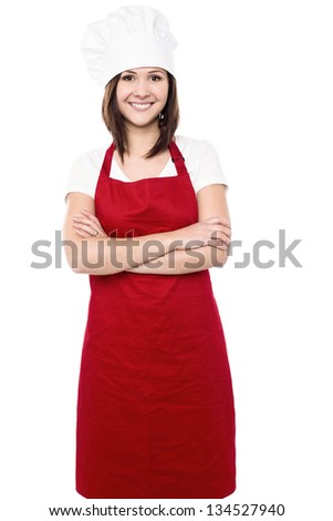 Confident young female chef with folded arms. - stock photo