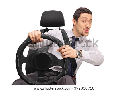 Confident young man driving and whistling with his mouth isolated on white background - stock photo