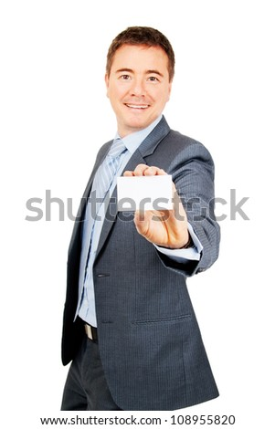 Confident young man holding blank copy space business card on isolated background - stock photo