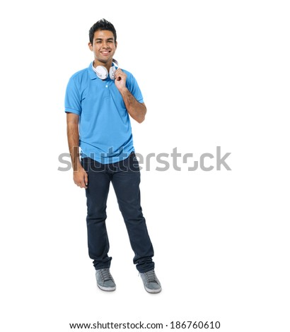 Confident Young Man Standing and Smiling - stock photo