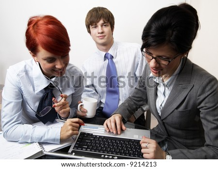 confident young manager at work with laptop - stock photo