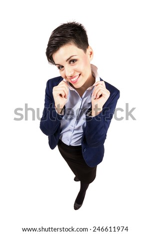 Confident young short hair business woman holding collar. High angle view wide lens full body length portrait isolated over white background. - stock photo