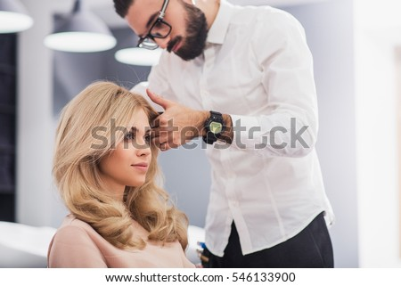 Confident young woman is looking at her reflection