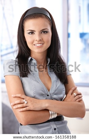 Confident young woman, looking at camera, smiling. - stock photo
