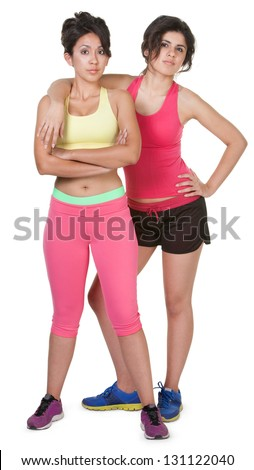 Confident young women in workout clothes on white background