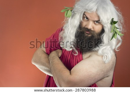 Confident zeus god or jupiter folds his arms and is ready for business - stock photo