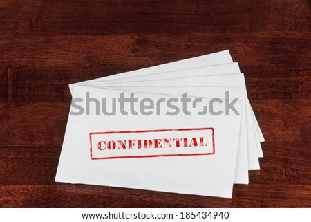 Confidential Rubber Stamp on a White Envelope - stock photo