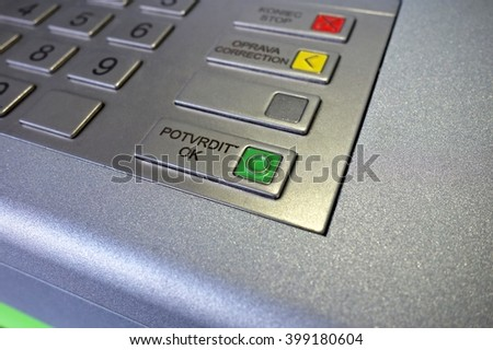 Confirm button on the ATM keyboard, macro - stock photo