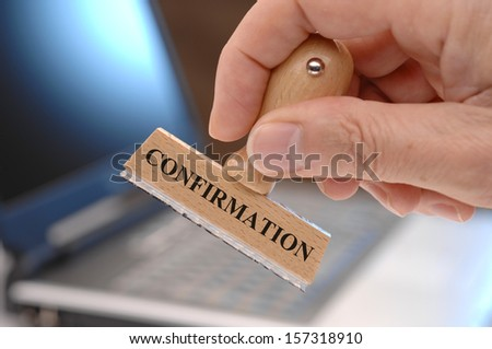 confirmation marked on rubber stamp - stock photo