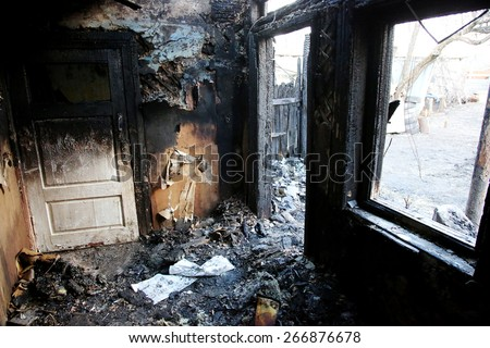 conflagration. Elements of the burned wood house