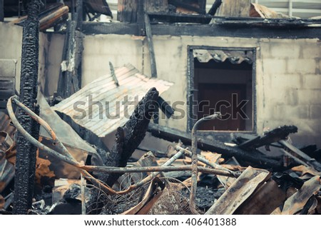 Conflagration fire damaged in summer house after blaze , process in vintage style - stock photo