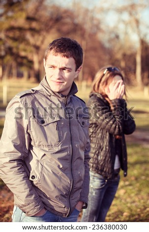 conflict and emotional stress in young people couple relationship outdoors  - stock photo