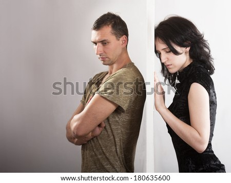 Conflict between man and woman concept. On opposite sides of the door. - stock photo