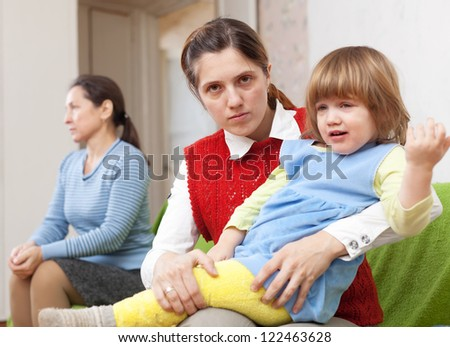 Conflict between the young mother with baby and her mother at home - stock photo