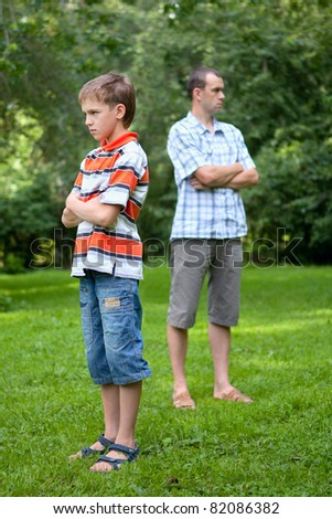Conflict of father and son, outdoor - stock photo