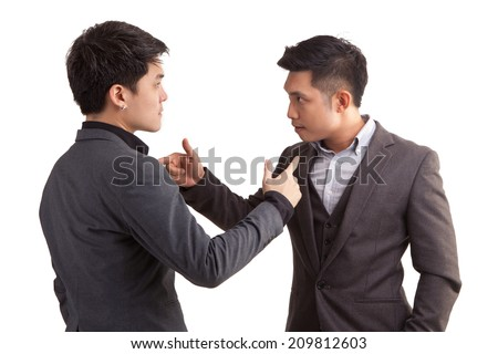 Conflict of two asian businessmen. Isolated on white background