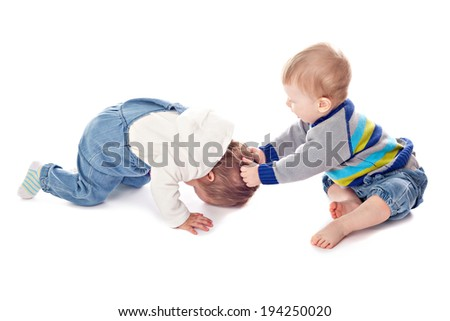 Conflict of two children. Studio shooting