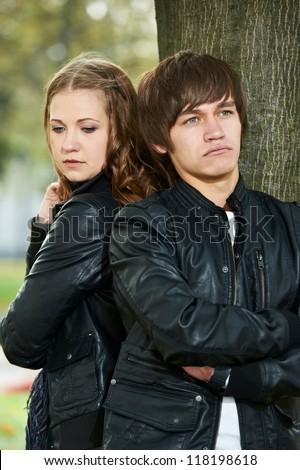 conflict offence and emotional stress in young people couple relationship outdoors - stock photo