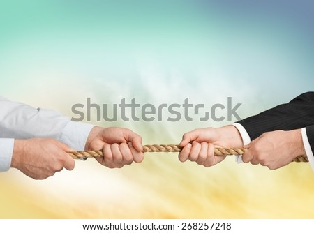 Conflict, Tug-of-war, Arguing. - stock photo