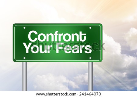 Confront Your Fears Green Road Sign, business concept  - stock photo