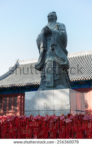 Confucius statue on the territory of the temple and museum of Confucius, Beijing, China - stock photo